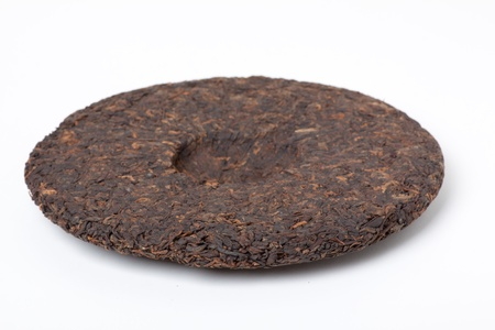 Disc of puer tea isolated on a white background  photo