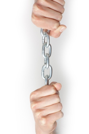 submissiveness: hands holding a chain  isolated on white Stock Photo