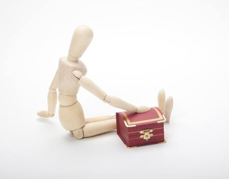 Wooden dummy with gift box, isolated on a white photo