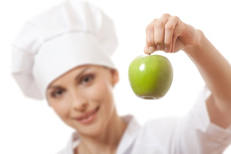 female chef: Smiling woman cook with green apple