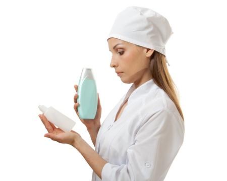 new medicine: doctor holding new medicine in plastic bottle