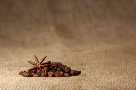 Coffee and Star Anise on sackcloth background with copyspace photo