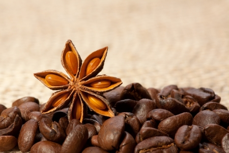 Coffee and Star Anise on sackcloth with copyspace photo