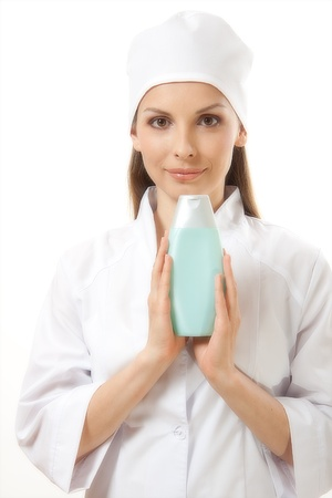 new medicine: doctor presenting new medicine in plastic bottle  Stock Photo