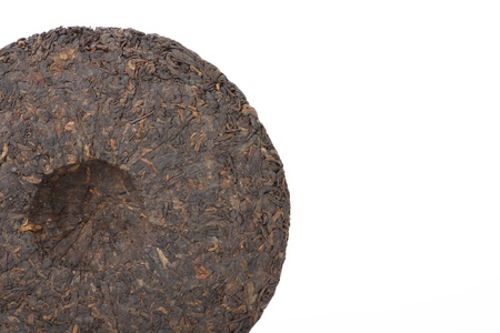 Disc of chinese puer tea isolated on a white background photo