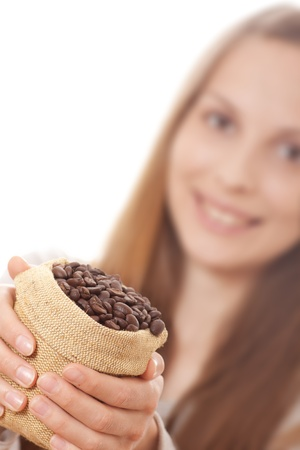 young woman holding a small bag of coffee beans photo
