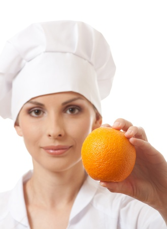 isoladed: Smiling woman cook with orange, isoladed on white background Stock Photo