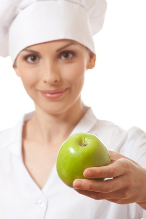 isoladed: Smiling woman cook with apple, isoladed on white background Stock Photo