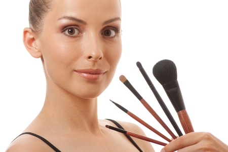 woman showing her makeup brushes, isolated on white background photo