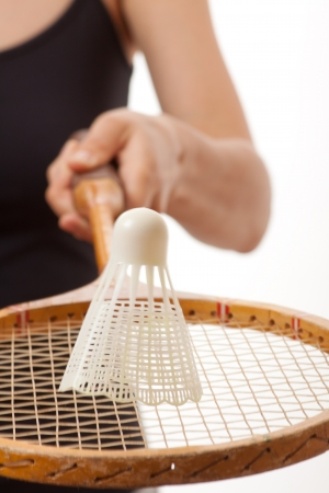girl with a badminton racket, isolated on white photo