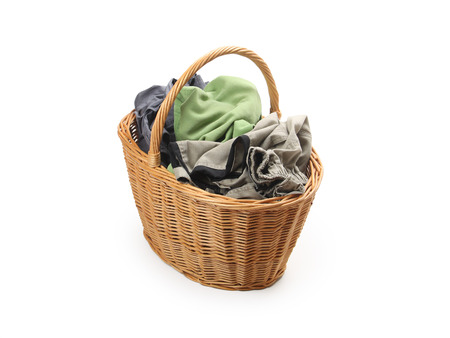 laundry in wicker basket, isolated on white background photo