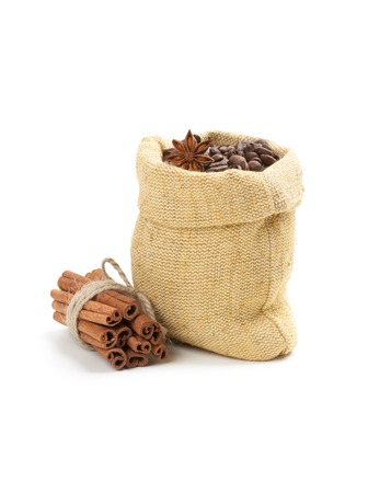 Coffee beans in burlap sack, isolated on white photo