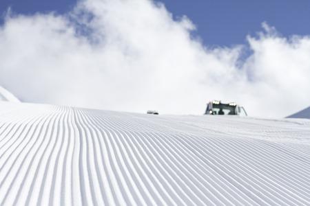 Fresh snow groomer tracks on a ski piste Stock Photo - 25729257