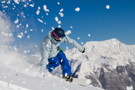 Snowboard freerider  in the mountains photo