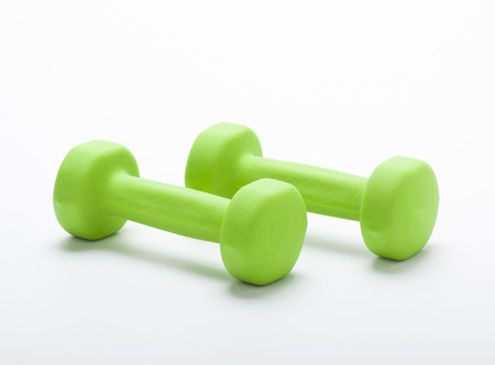 small green dumbbells,  isolated in white background photo