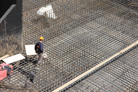 site: workers make metal reinforcement for the concrete foundation