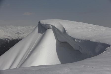 avalanche: Snow cornice in mountains of Caucasus, Russia. Avalanche danger