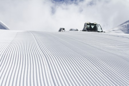 Fresh snow groomer tracks on a ski piste photo