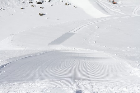 Fresh snow groomer tracks on a ski piste Stock Photo - 25730997