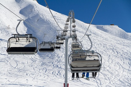 wintersport: Chairlift on a ski resort Editorial