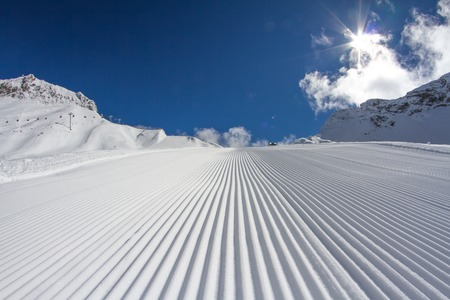 Fresh snow groomer tracks on a ski piste Stock Photo - 25731419