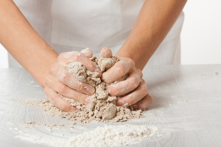 knead: hands knead rye Stock Photo