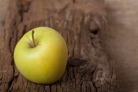 Apple on wooden board photo