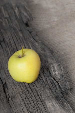 Apple on wooden board photo