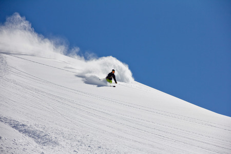 heli: Skier in deep powder, extreme freeride Stock Photo