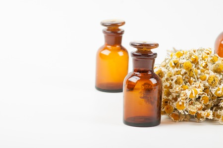 matricaria: Dry chamomile and a bottles