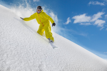 Snowboard freerider moving down in snow powder Reklamní fotografie