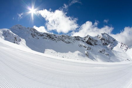 perfectly groomed empty ski piste photo