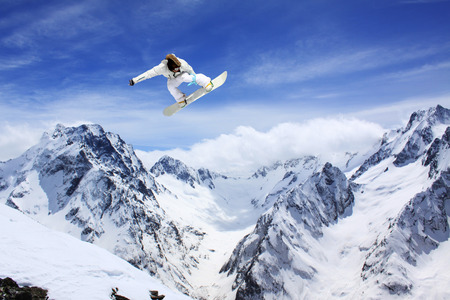 flying snowboarder on mountains  photo