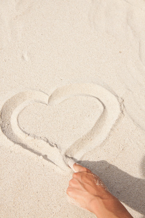 Heart drawn in the sand  Beach background  photo