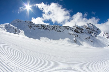 perfectly groomed empty ski piste, ski resort photo