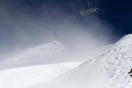 heli: ski resort in the mountains and helicopter