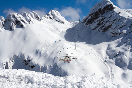 heli: ski resort in the mountains, ski lift and helicopter