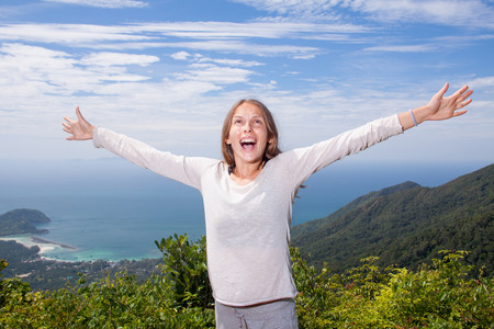 outcry: young woman screams in the mountains