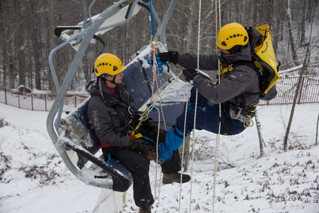 mounter: SOCHI, RUSSIA - DECEMBER 12, 2013: Rescuers rehearse rescue on the ski lift. Mountain resort Rosa Khutor.