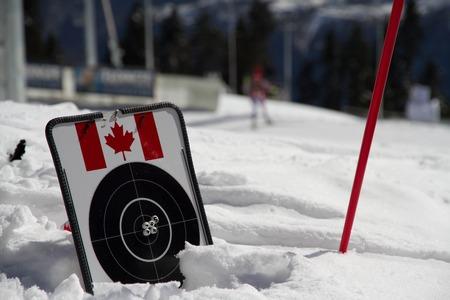 gunfire: target for biathlon on the snow witn canadian flag