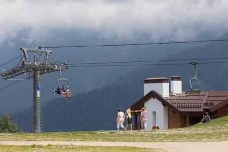 SOCHI, RUSSIA – JULY 23, 2015: Tourists on the ski lift, mountain resort Rosa Khutor (Krasnaya Polyana)
