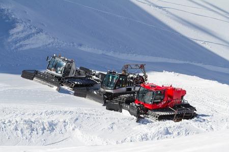 snowcat: SOCHI, RUSSIA - MARCH 22, 2014: Ratraks, grooming machines, special snow vehicles in ski resort.