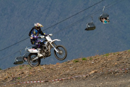 off road racing: SOCHI, RUSSIA � AUGUST 16, 2014: Off-road motorcycle rider trains in summer mountains Editorial