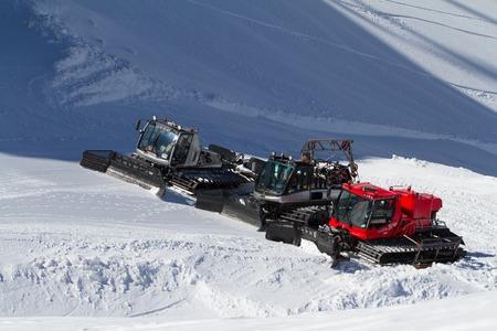 snow grooming machine: SOCHI, RUSSIA - MARCH 22, 2014: Ratraks, grooming machines, special snow vehicles in ski resort.