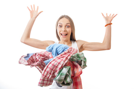 woman throws a pile of clothes, isolated on white background photo