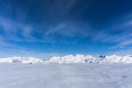 off piste: View on mountains and blue sky above clouds, Krasnaya Polyana, Sochi, Russia