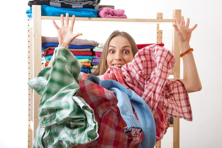 washhouse: woman throws a pile of clothes, isolated on white background