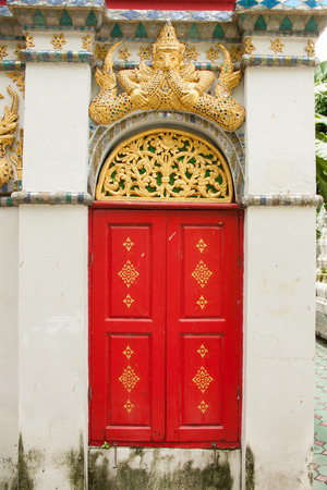 red door: Red door of ancient Thai temple