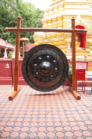Thai traditional gong or tam-tam in Buddhist temple photo