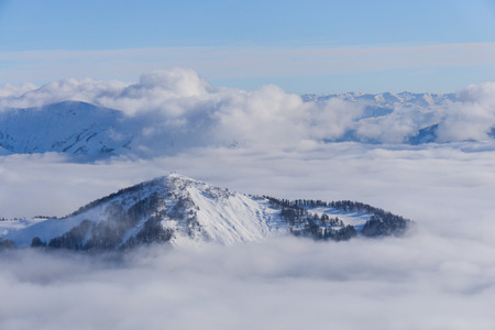 piste: View on mountains and blue sky above clouds, Krasnaya Polyana, Sochi, Russia